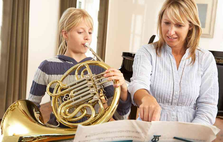 Student Taking French Horn Class at International School of Music in Rockville and Chevy Chase