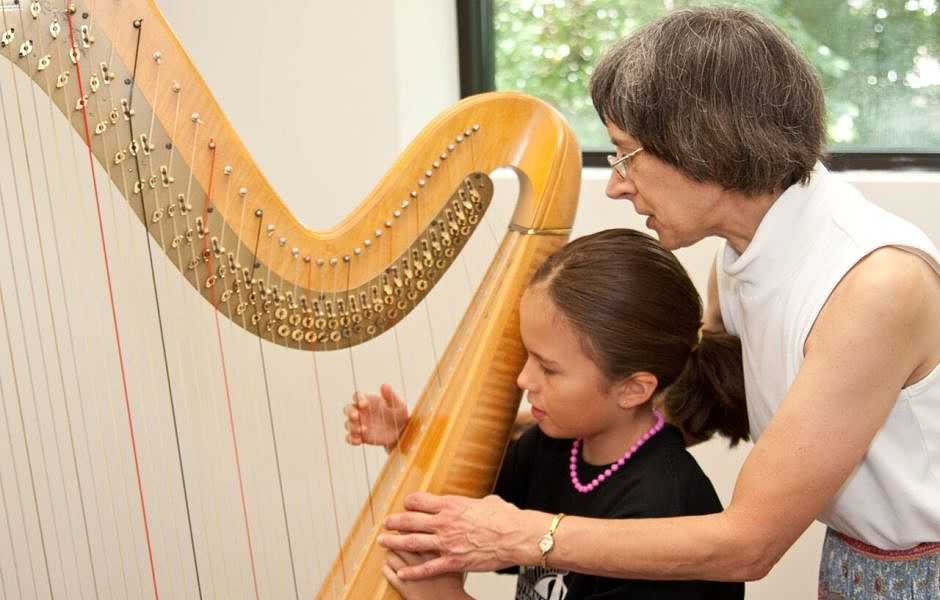 Student taking Harp Class at International School of Music in Rockville and Potomac
