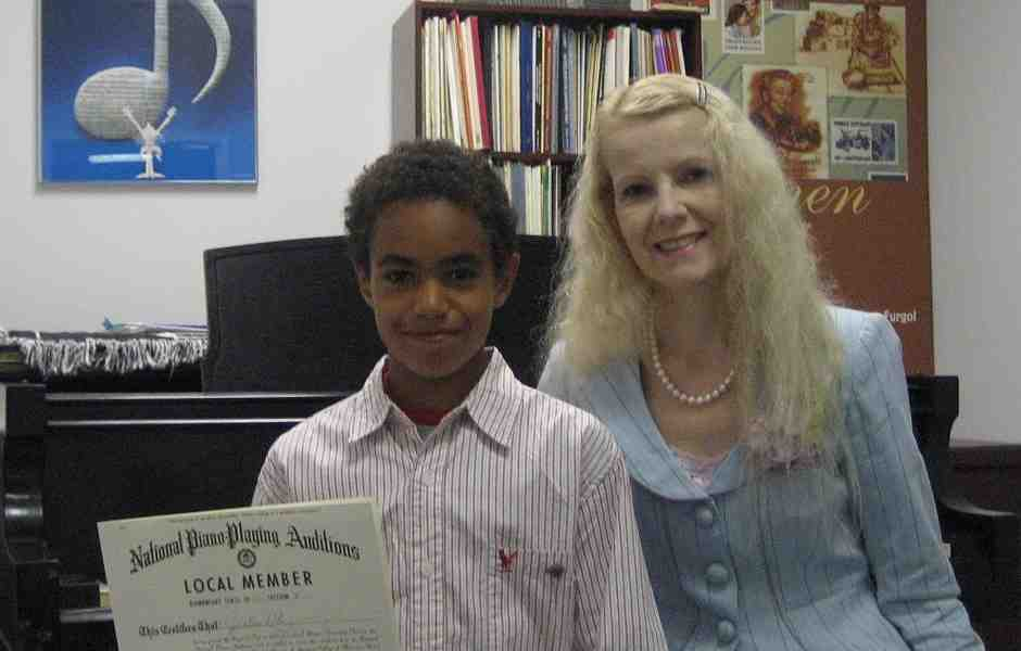 International School of Music piano student holding the Piano Guild Audition Diploma in Bethesda