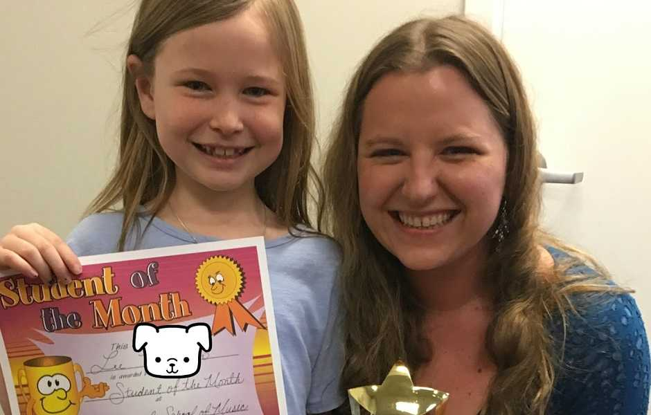 International School of Music student holding achievement trophy
