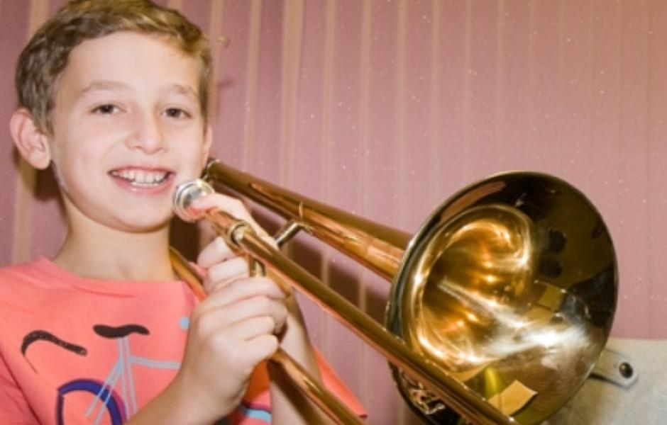 Trombone Student participating in performance evaluation program at International School of Music