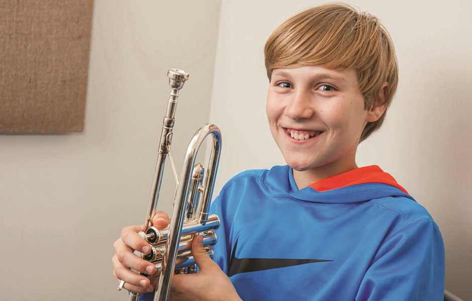 Trumpet Student participating in performance evaluation program at International School of Music